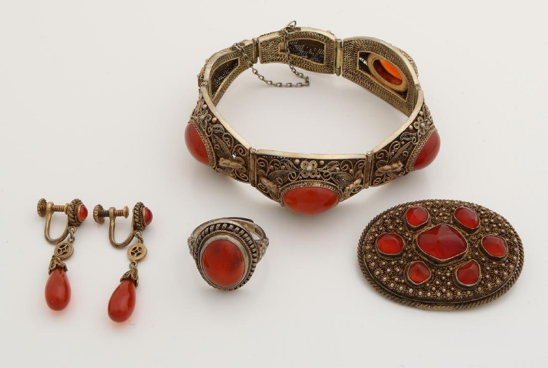 A silver plated set with carnelian: a bracelet, brooch, ring and earrings.