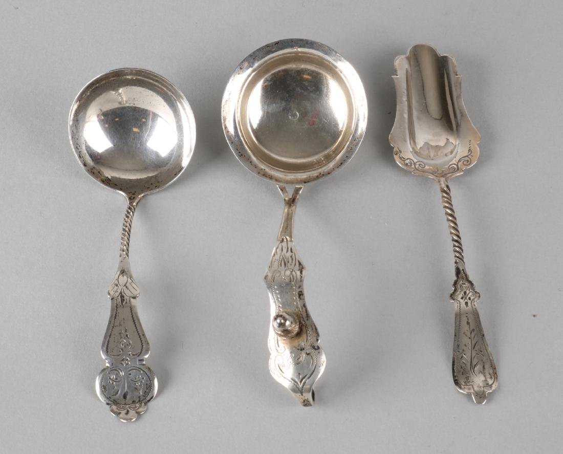 Three silver spoons, 835/000, consisting of 2 cream spoons and a sugar scoop wit