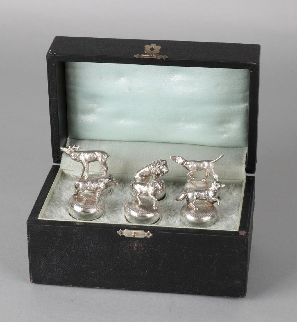 Six plated decorative corks with various animal figures. Signed WMF. New in orig