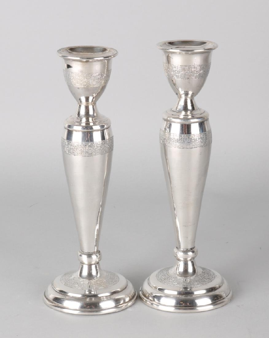 Set of two silver candlesticks, 835/000, on round base with a column with a mean