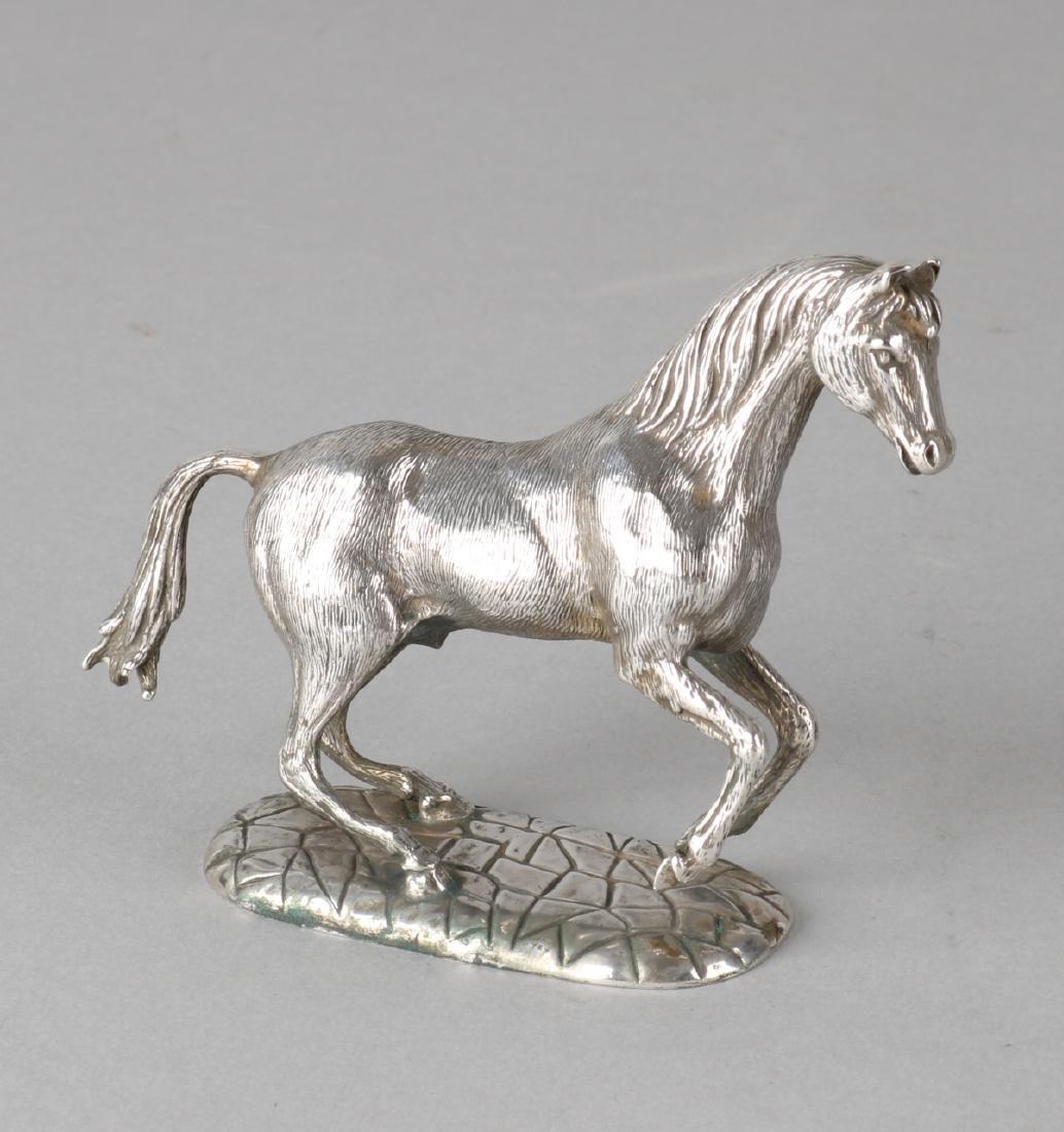 Silver horse, miniature, 835/000, on oval silver base. 11x3x8cm. In good conditi