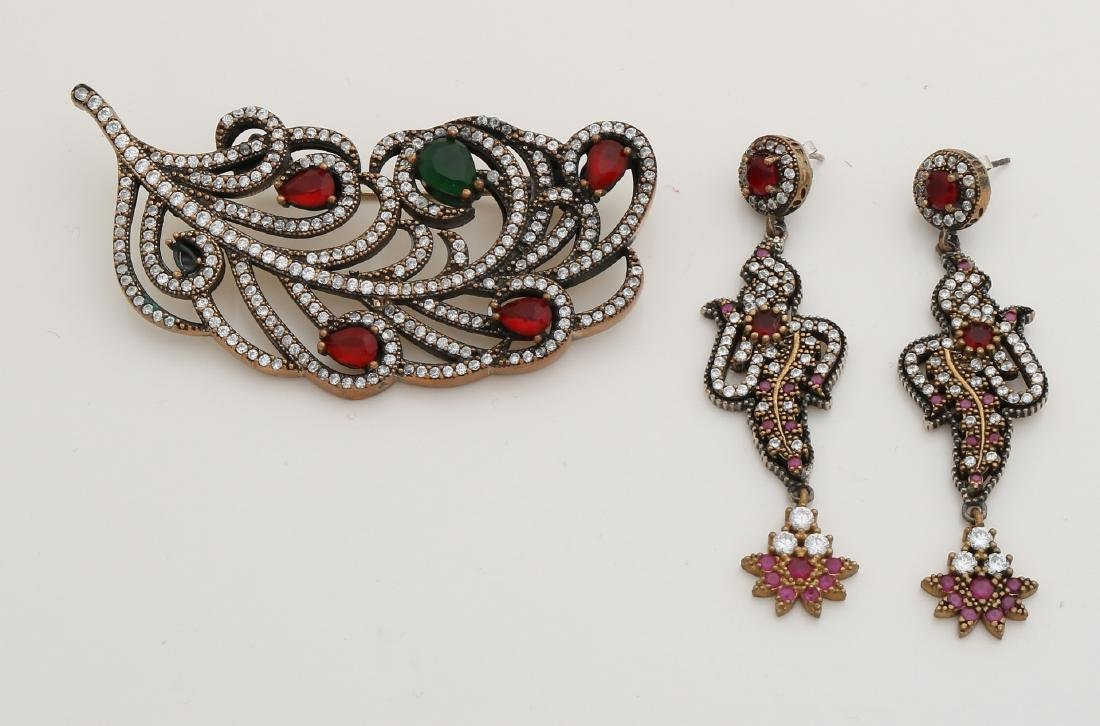Silver-plated brooch and earrings, antique style, with colored stones.  Brooch i