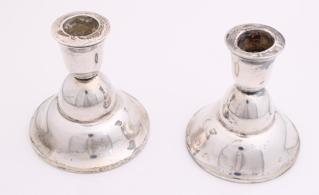 Lot with two candlesticks, one silver candlestick, low model MT .: Gerritsen and