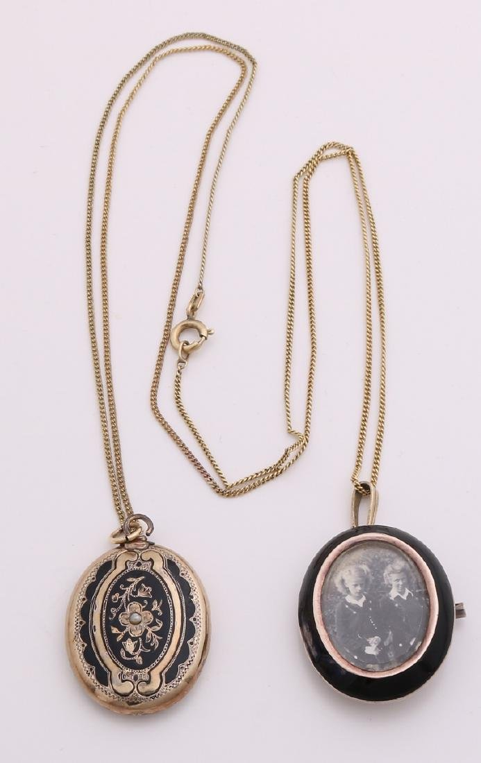 Two medallion pendants, one gold on silver pendant / brooch with black enamel ed