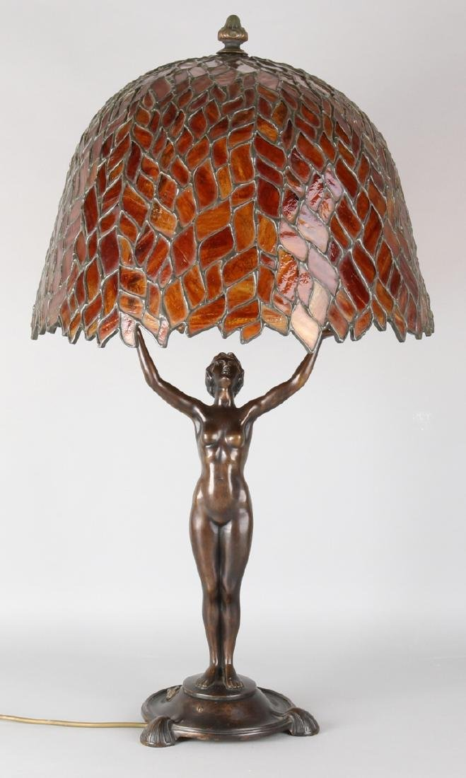 Large original bronze art nouveau lamp with monogrammed stained glass lampshade.