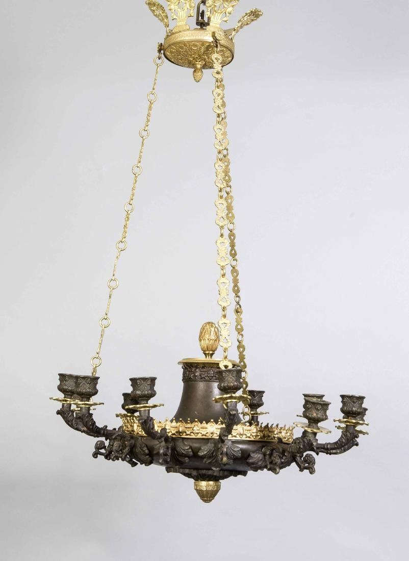 19th Century Napoleon III Empire chandelier for twelve candles. Patinated and gi