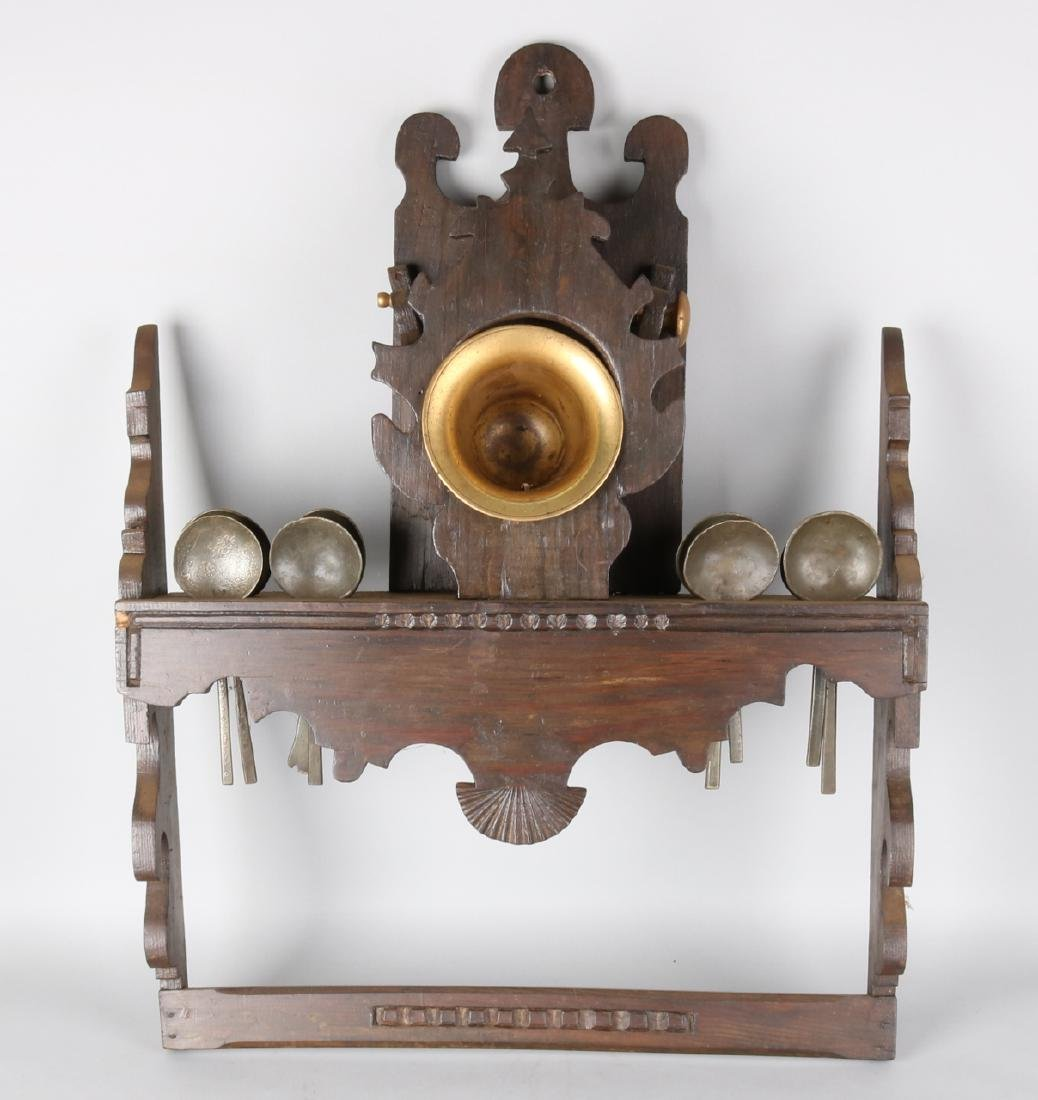 Antique spoon rack with nine pewter spoons and brass mortar. Circa 1800. Size: 7