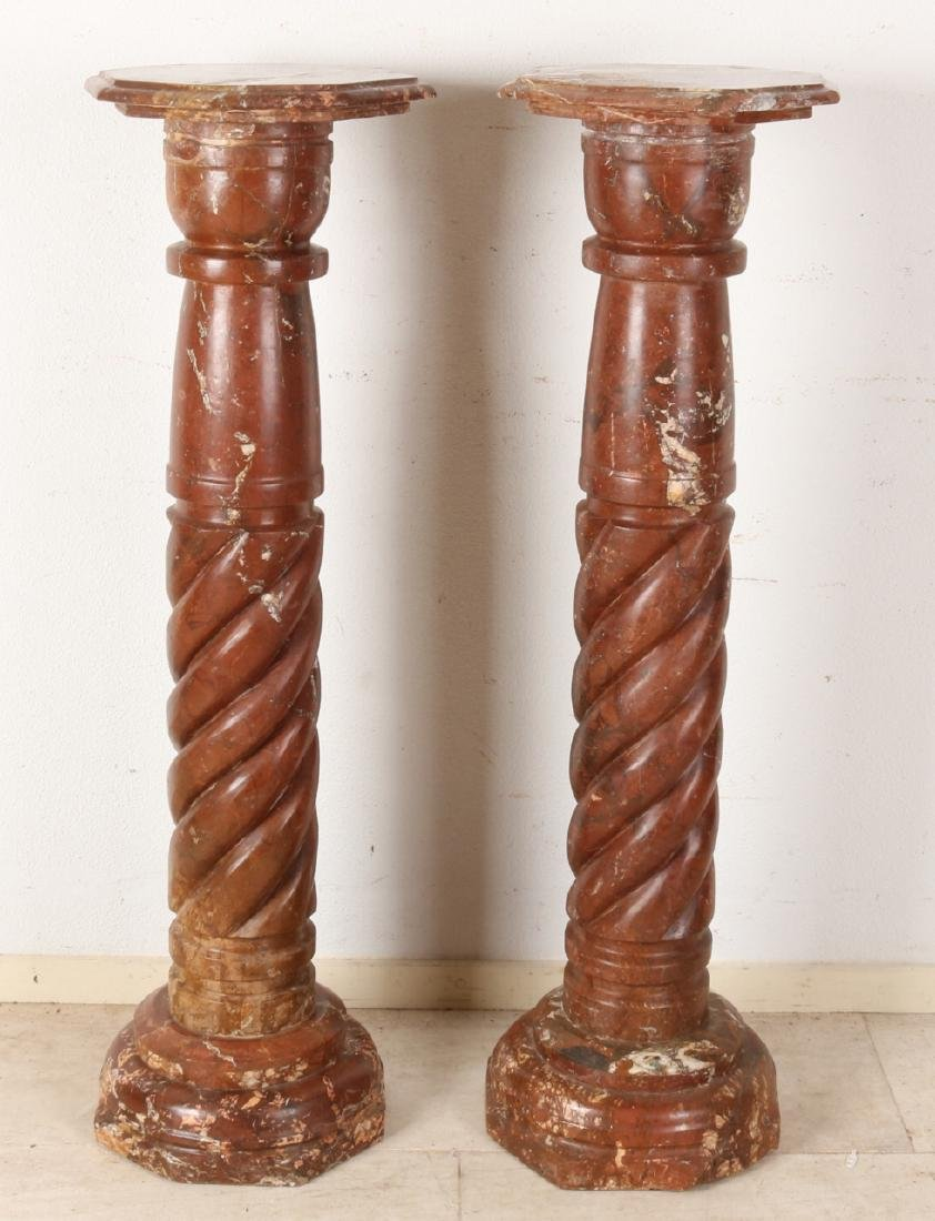 Two large antique red-brown marble columns (piedestals), with eight-edged foot +