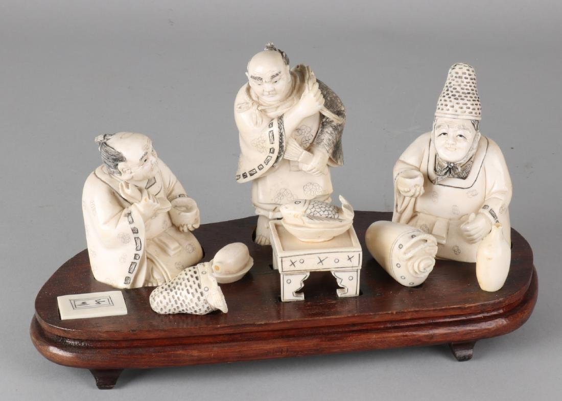 19th Century Japanese ivory figures group on wood-strutted base with eight ivory