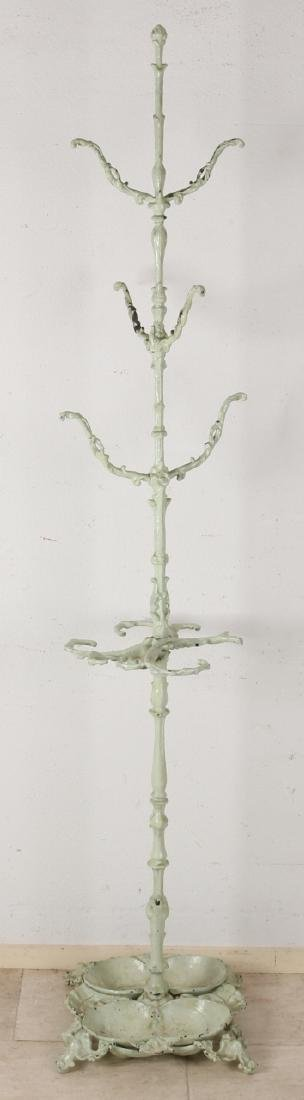 Antique standing cast iron coat rack with drip trays. Circa 1900. Size: 195 cm.