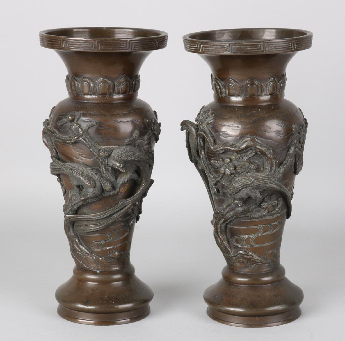 Two 19th century Japanese bronze vases with birds of paradise and blossom branch