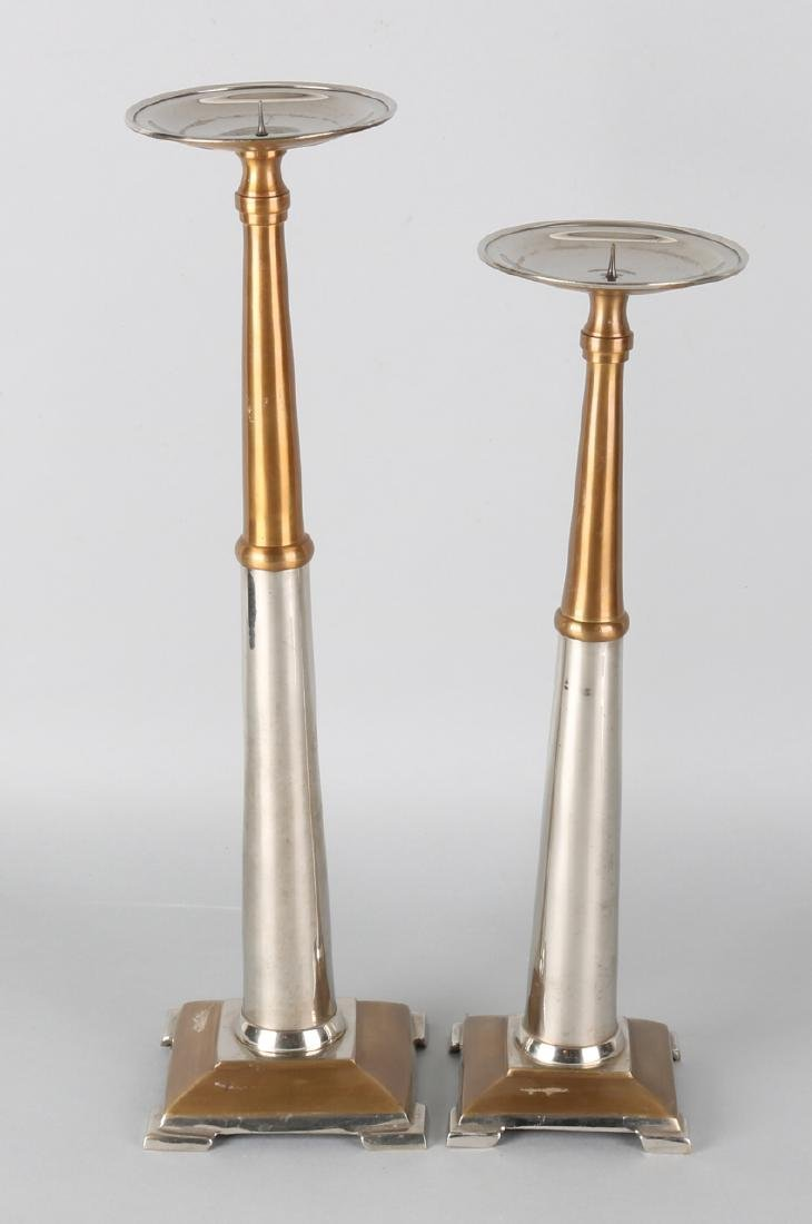 Two large Art Deco-style brass plated candlesticks. 20th century. Size: 38 - 44