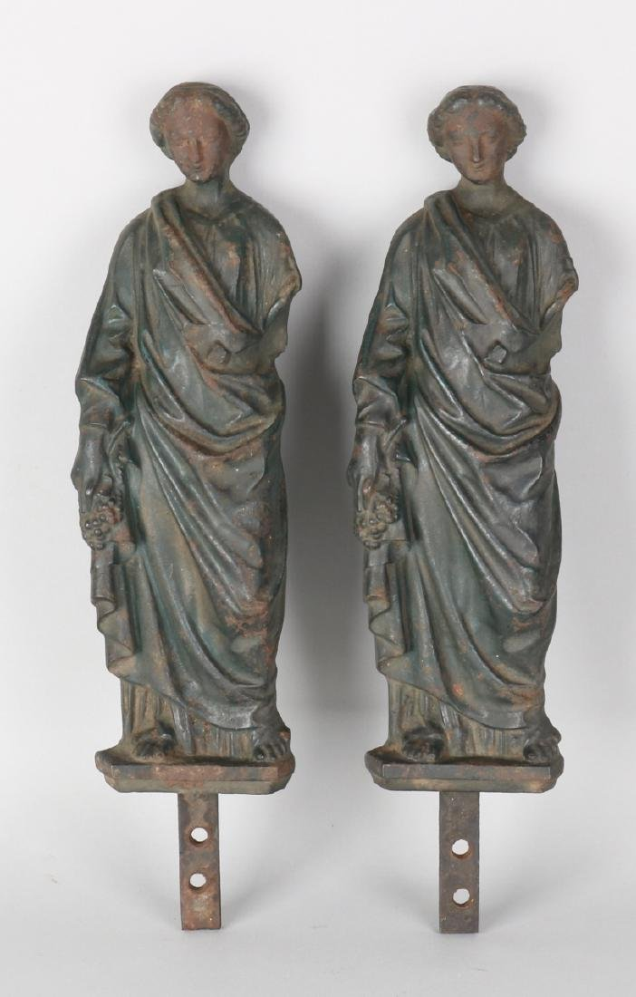Two early 19th century cast iron fireplaces with Greek ladies. Empire. Size: 29