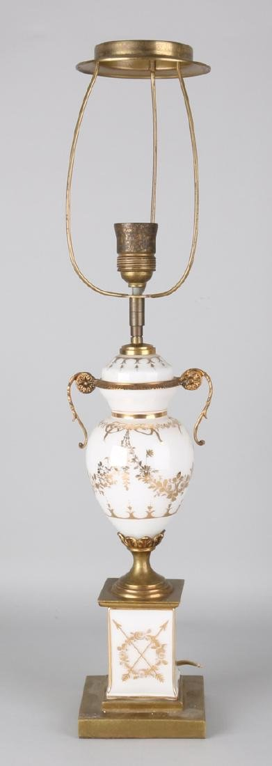 Old opaline table lamp with gilding and brass in Louis Seize style. 20th century