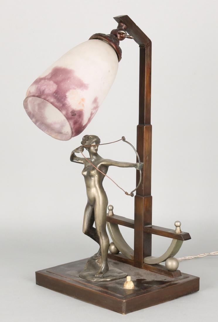 Beautiful Art Deco metal table lamp with archery naked lady. Circa: 1930 - 1940.