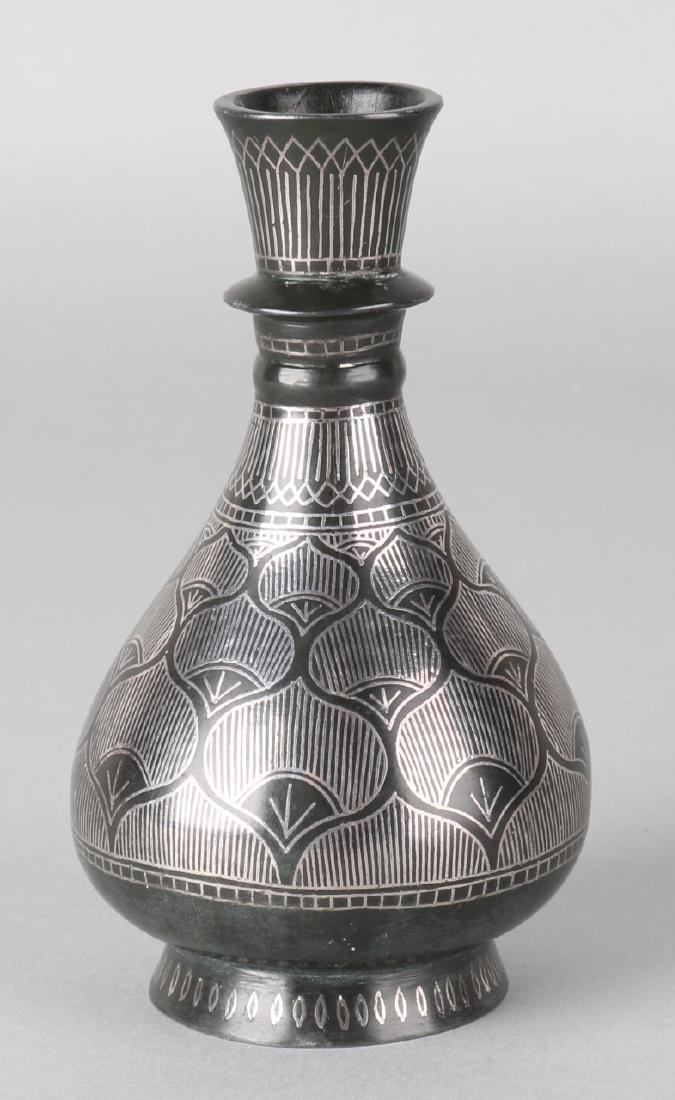 Antique Persian bronze vase with silver inlay. Circa 1900. Size: 12.7 cm. In goo