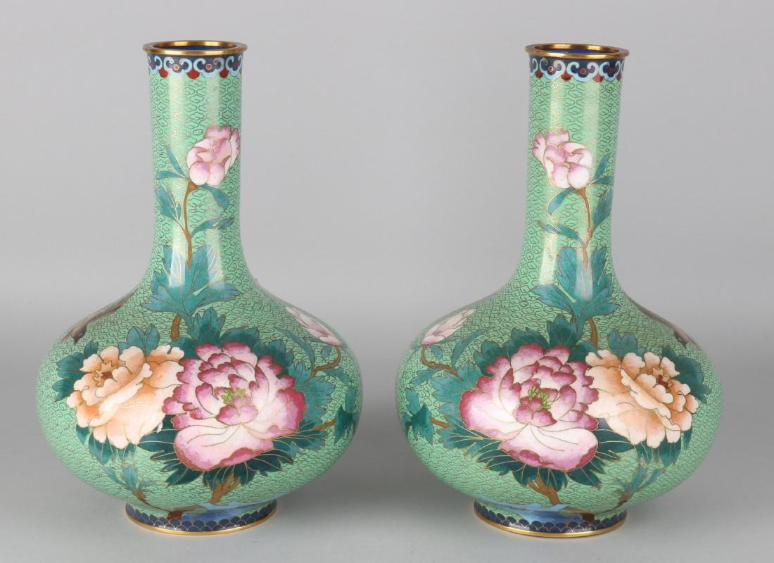 Two green Japanese cloisonne vases with floral decors and birds. Size: 27 x 16 c