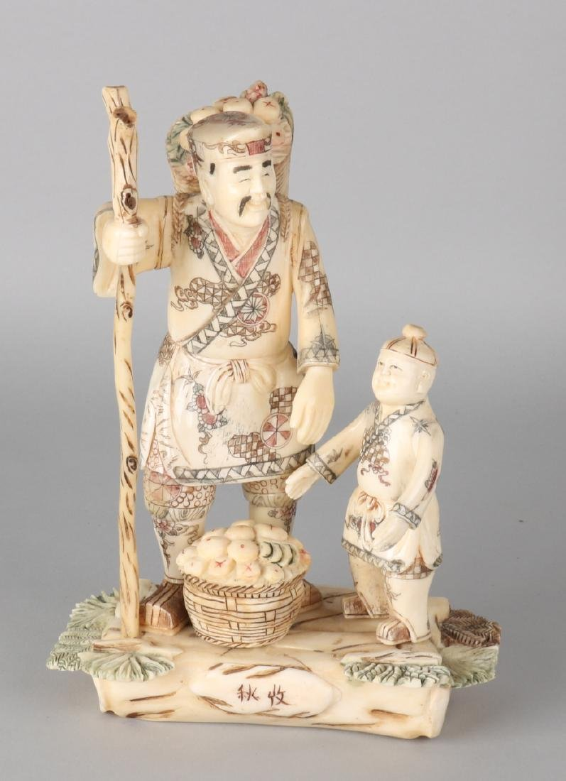 Large antique Japanese legs figures group. Figure with fruit and child. Signed.