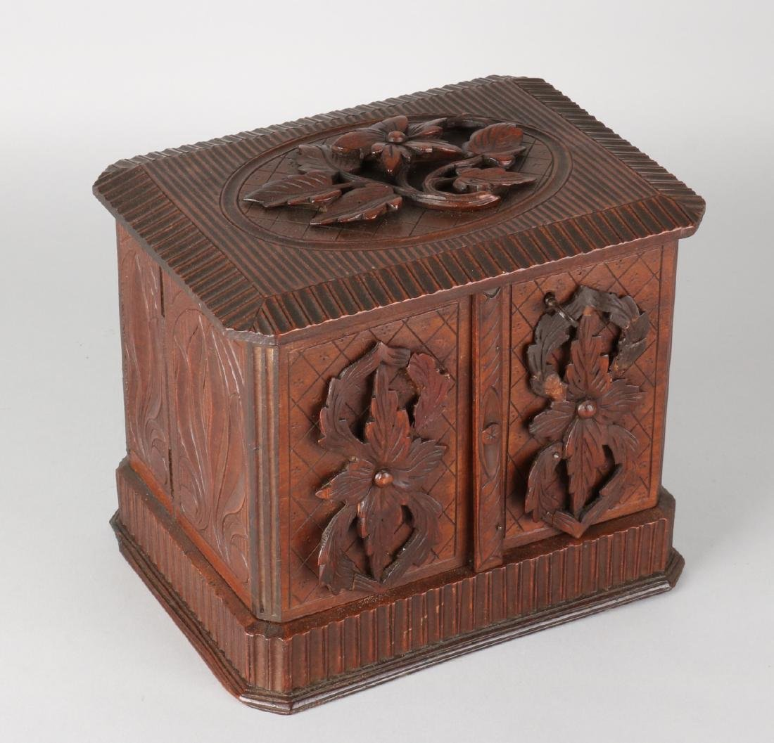 Antique Black Forest cigar humidor with floral carving. Circa 1900. Size: 20 x 2