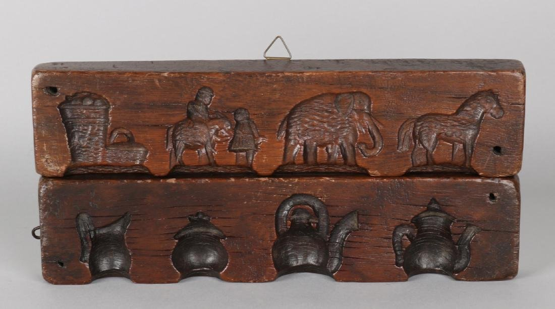 Two pieces of 18th - 19th century walnut gingerbread planks with animals and cho