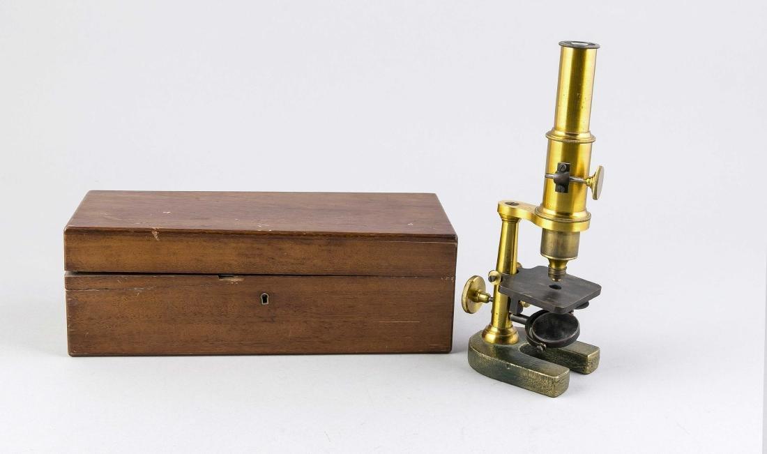 Antique brass microscope in walnut box with accessories. Circa 1920. Light oxida
