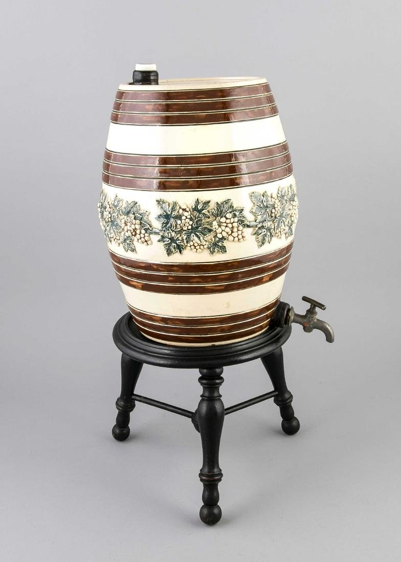 19th Century ceramic vessel with grape vines, tap and wooden base. Size: 61 x 27