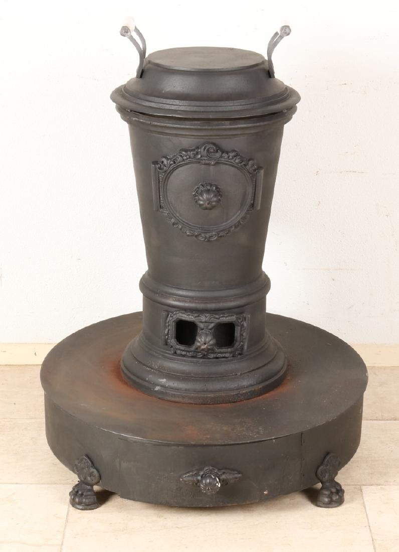 Large old cast iron stove with porcelain handles and claw feet. 20th century. Si