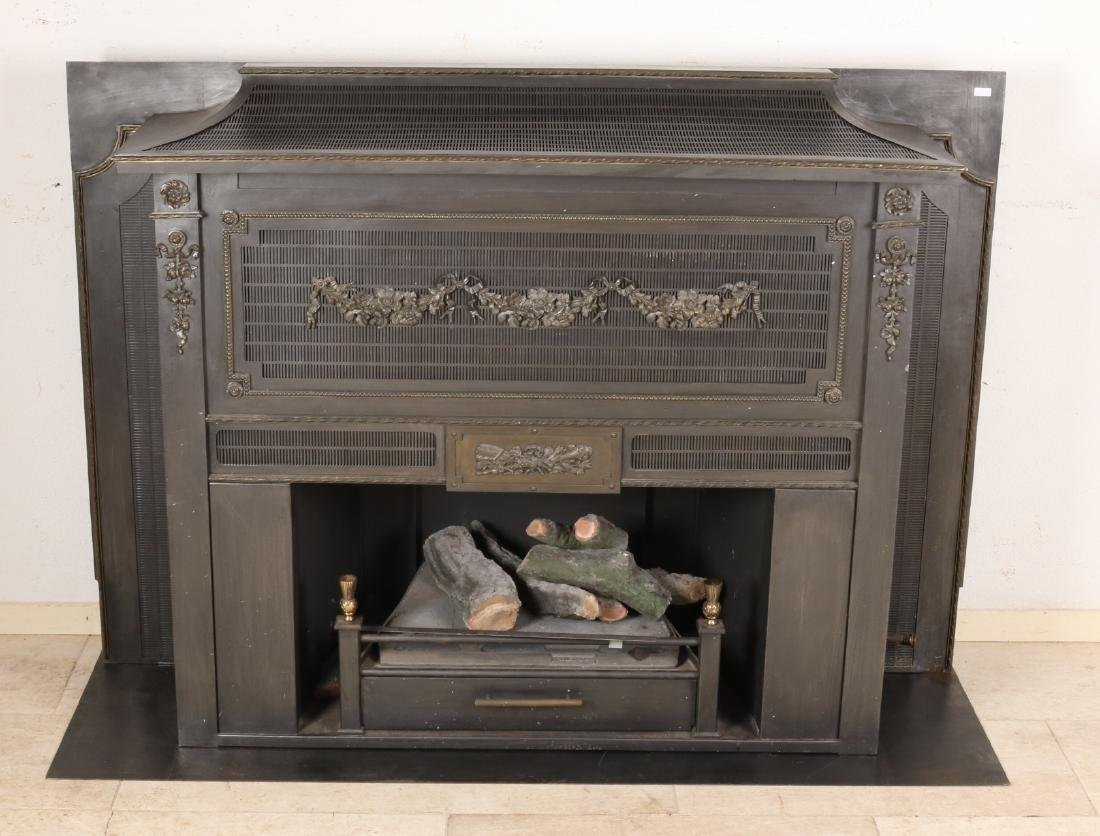 Large old cast iron gas fireplace with roof. 20th century. Size: 100 x 140 x 37