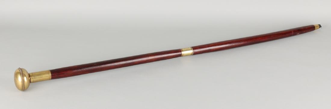 Old walking stick with clockwork in brass sphere. 21st century. Size: 94 cm. In