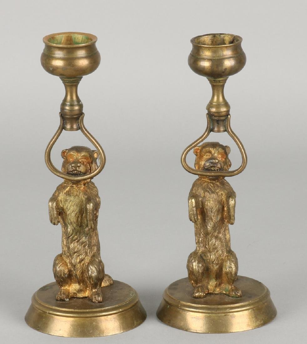 Two small antique bronze candlesticks with dogs and residual gilding. Circa 1880