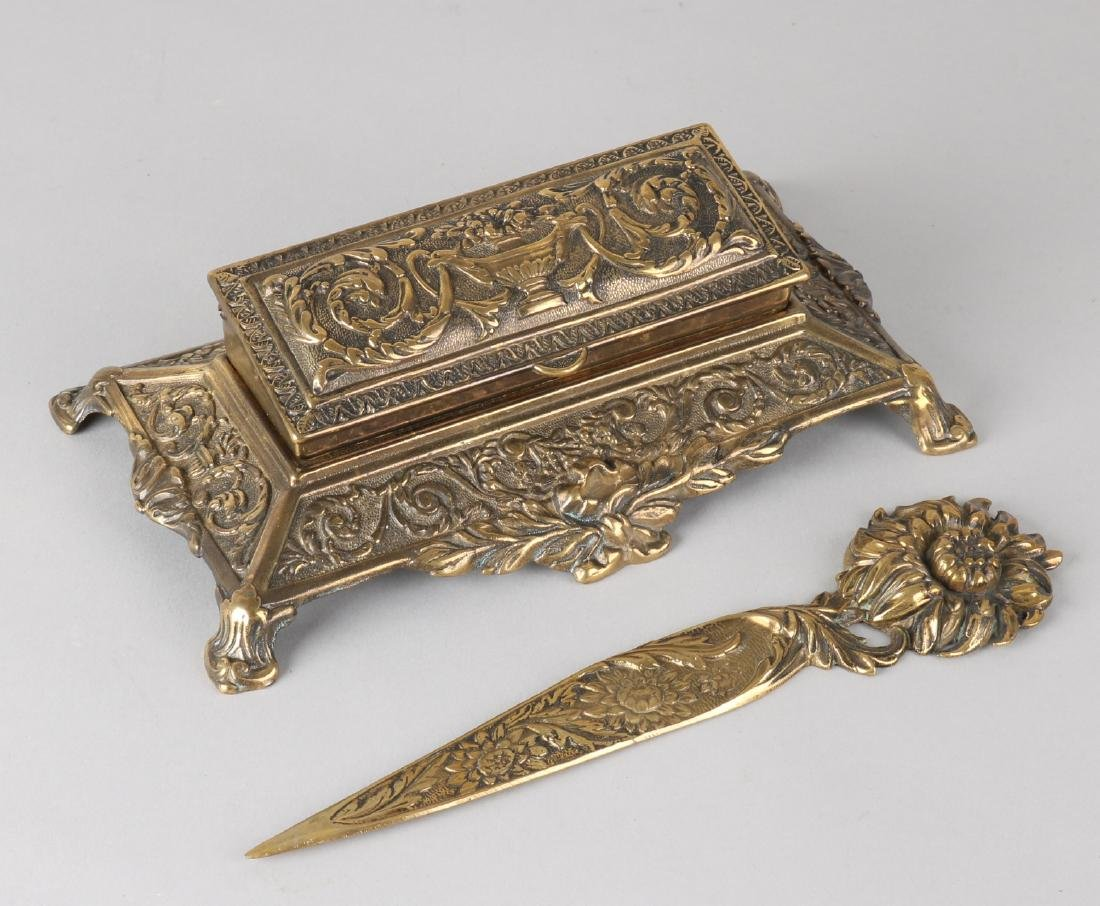 Antique brass crafted desk set. Stamp and Art Nouveau letter opener. Circa 1900.