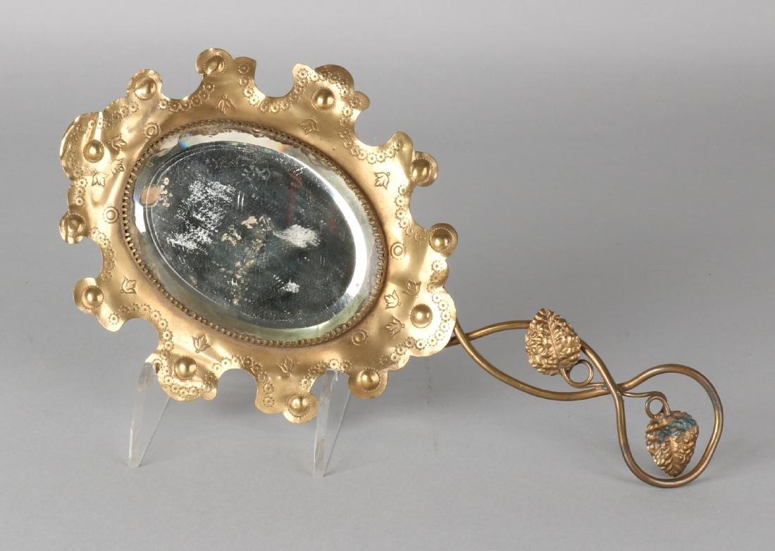 Antique copper carved hand mirror, facet cut. Circa 1900. Size: 29 cm. In good c