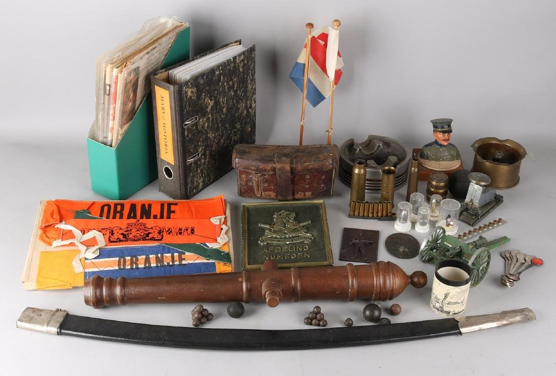 Lots with various militaria articles including: various newspapers / documents,
