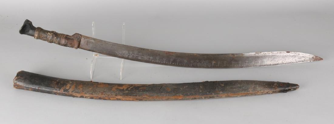 19th Century Arabian saber with Arabic script on lemet. Raises leg and covered w