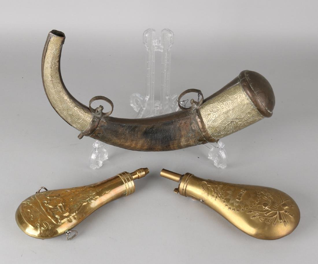Three different old / antique powder horns. Once Oriental, of horn and brass. Tw