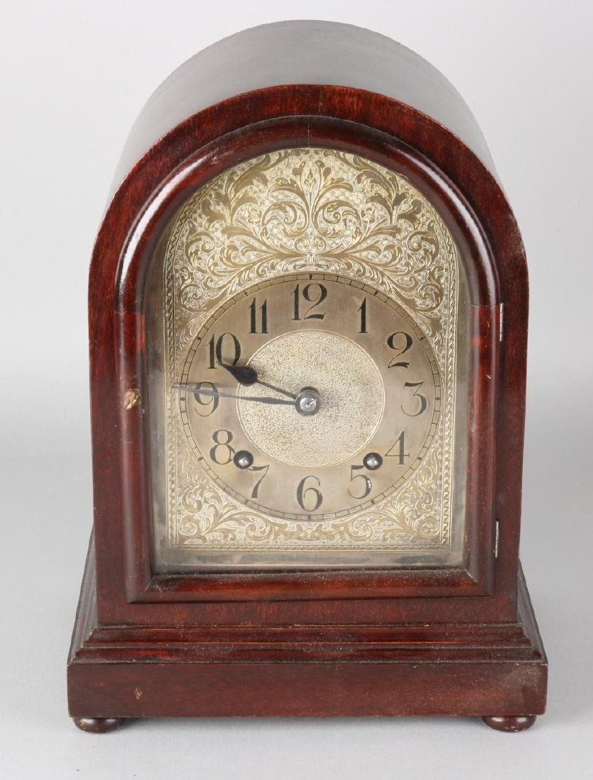 Antique English mahogany table clock with snek and quarter turn on six chime bar