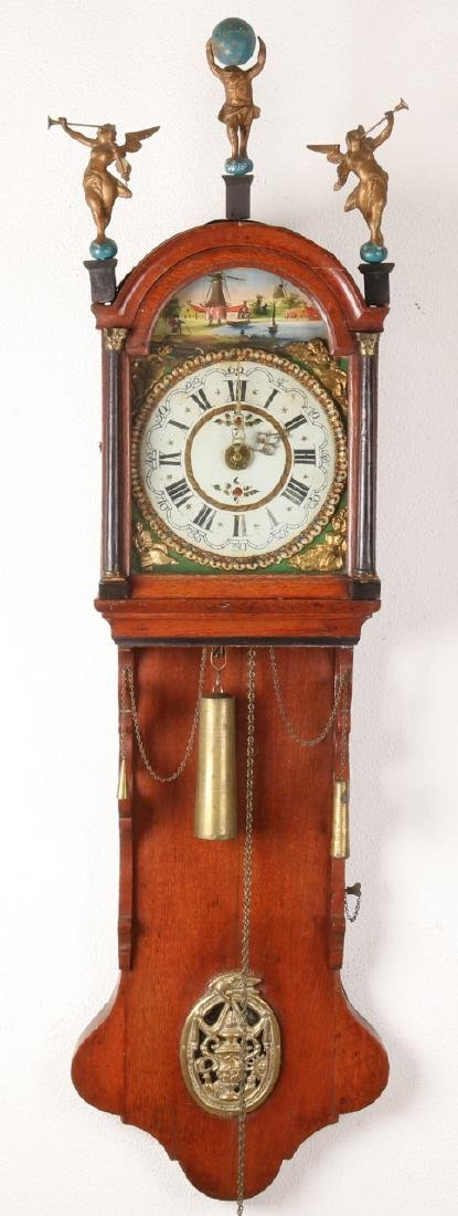 Early 19th century oak Frisian tail clock with wooden dolls, wedding wreath and