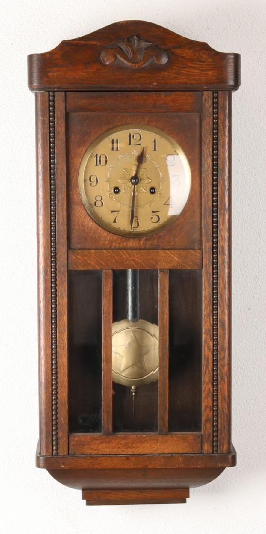 Antique German oak bim-bam regulator. Circa 1920. Size: 78 cm. In good condition