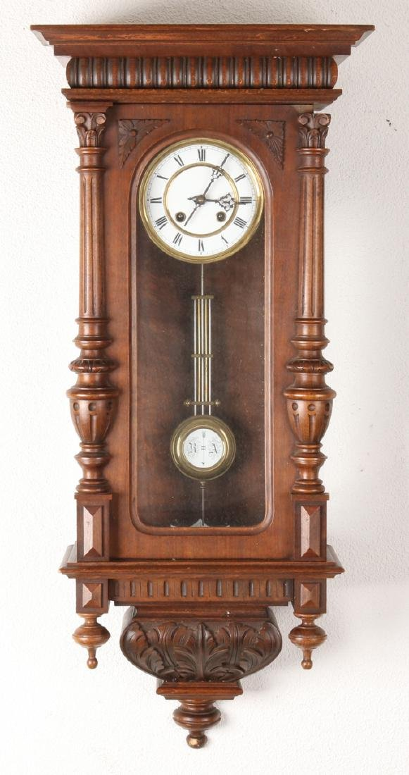 Antique German walnut Kienzle regulator with half Corinthian columns. Size: 86 c