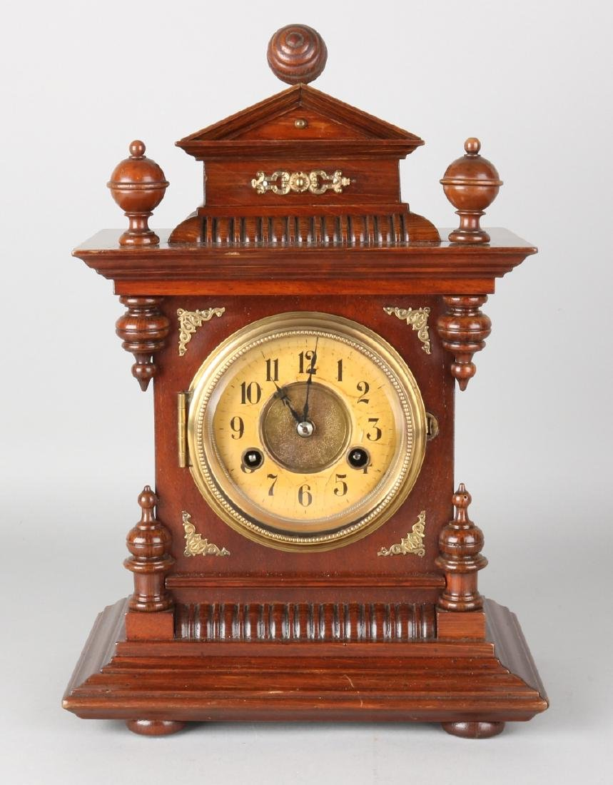 Antique German walnut Junghans table clock with brass fittings. Circa 1890. Size