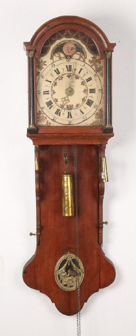 Antique oak Frisian tail clock with moon stand and date indication. Circa 1800.