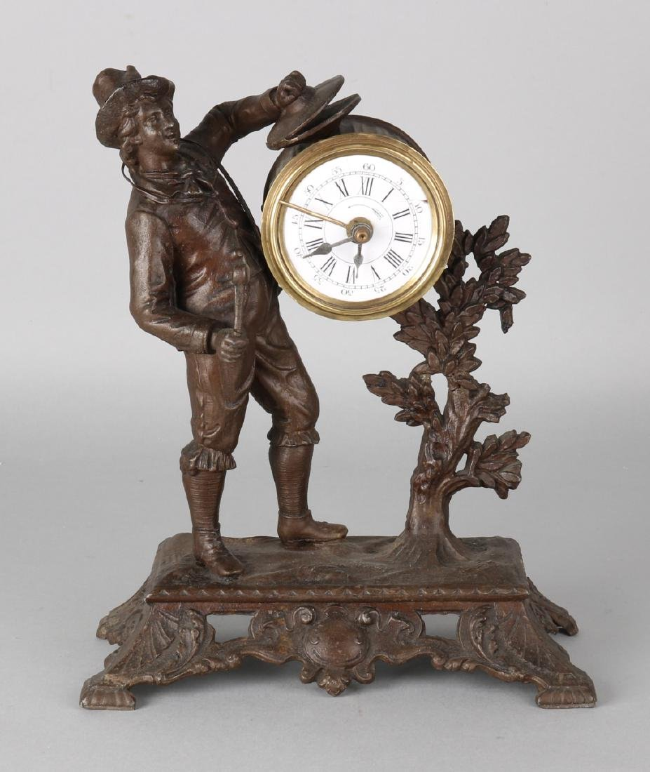 Antique desk alarm clock. Circa 1890. Man plays drum. Composition metal with bra