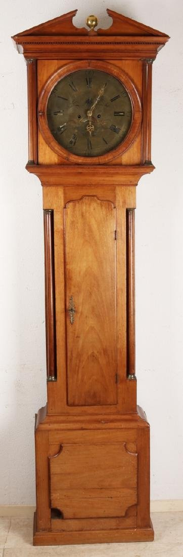 Antique English mahogany standing clock with full columns and large engraved pla