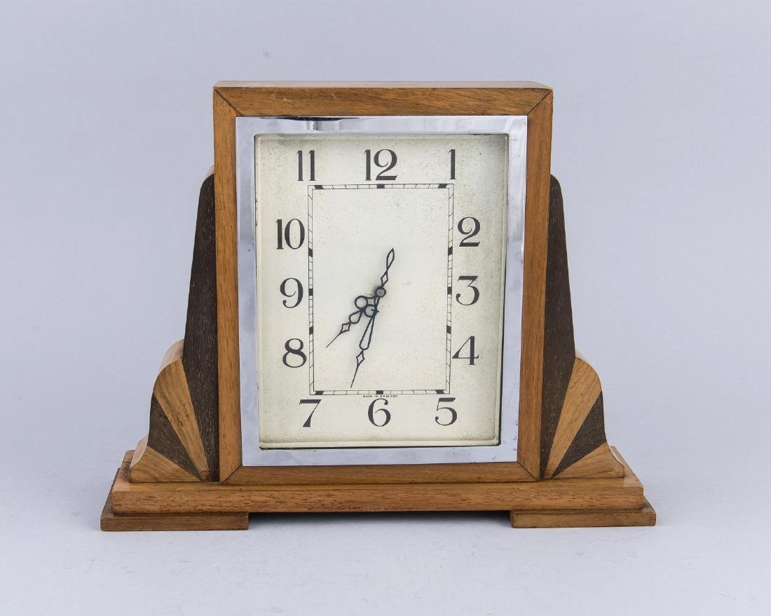 Antique English mahogany table clock with chrome. Circa: 1930. Size: 24 x 31 x 8