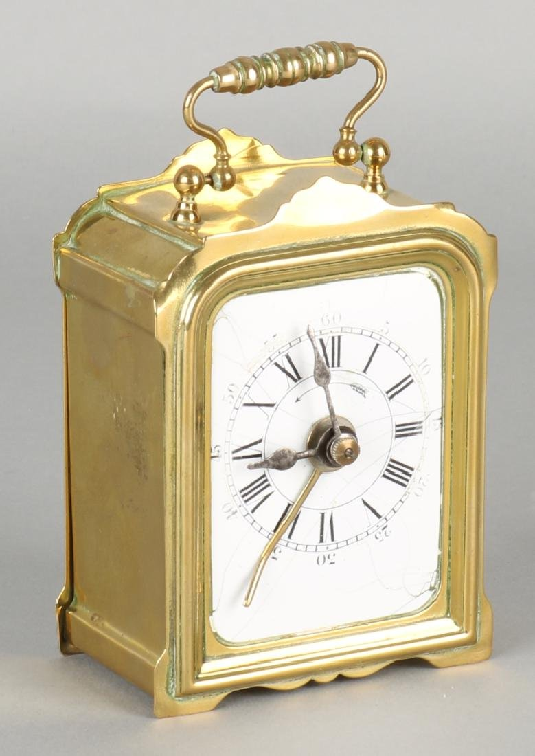 Antique French brass travel alarm clock with enamel dial. Crackle. Circa: 1870.