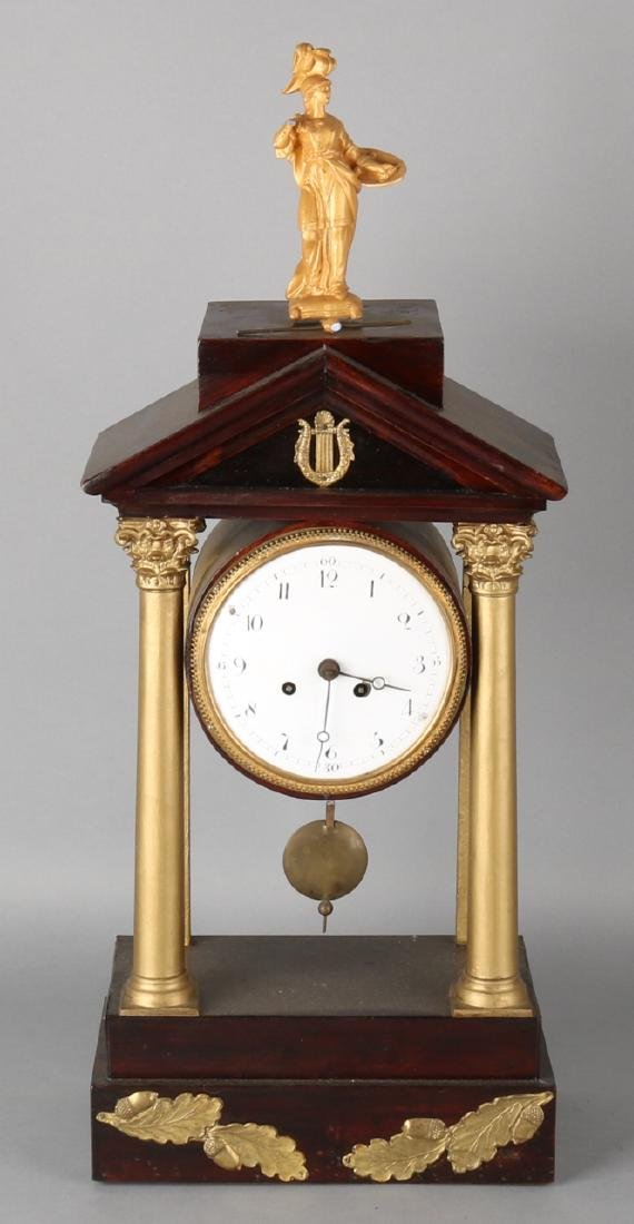 South German gold colored portal pendulum of mahogany. Circa 1800. Clock with ha