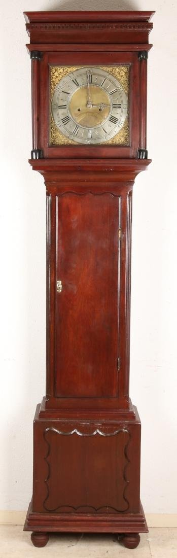 Antique English mahogany standing clock with 18th century movement. Clock has an