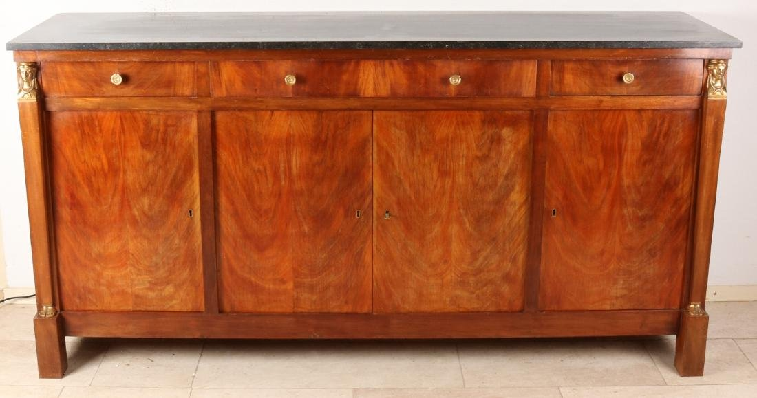 Large mahogany Empire dresser with gilt brass caryatids and black marble top. Fo