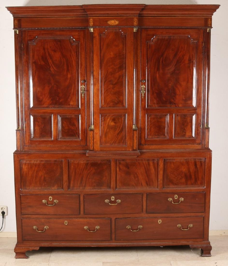 Early 19th century English cabinet, mahogany with intarsia and brass capitelles.