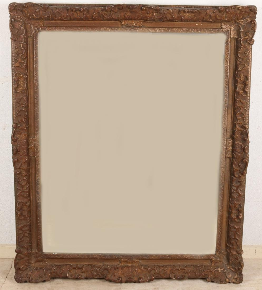 Large 19th century facet cut mirror with bronze colored Baroque frame. Size: 87